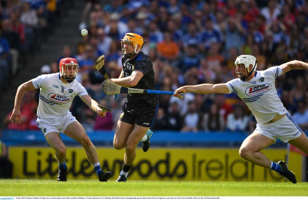 14 July 2019; Séamus Callanan of Tipperary in action against Jack Kelly and Ryan Mullaney of Laois during the GAA Hurling All-Ireland Senior Championship quarter-final match between Tipperary and Laois at Croke Park in Dublin. Photo by Ray McManus/Sportsfile